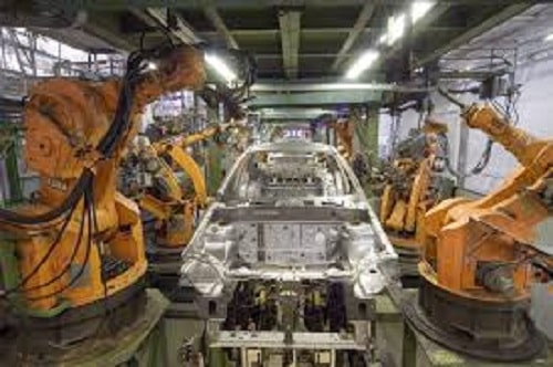 Factory car industry during car assembly by welding guns